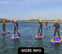 Group of people Paddle Boarding on Anglesey